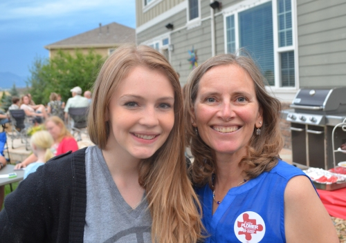 Kathy's oldest daughter is happy to help her mom at the petition signing party.
